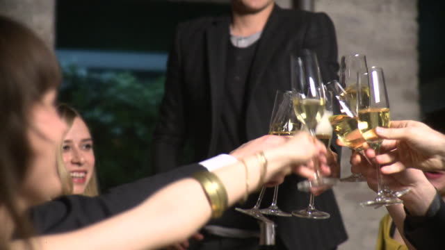 cu friends toasting with champagne at restaurant, new york city, new york, usa - spumante video stock e b–roll