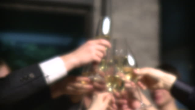 cu focusing friends toasting with champagne at restaurant, new york city, new york, usa - champagne flute stock videos and b-roll footage