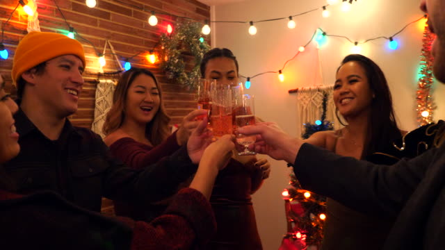 ms friends toasting with champagne glasses during holiday party in home - 20 29 years stock videos & royalty-free footage