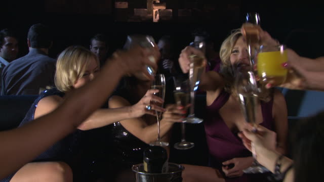 ms friends toasting with champagne in bar / london, uk - celebratory toast stock videos and b-roll footage