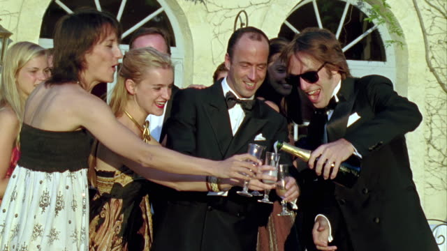 cu, friends toasting with champagne, saint ferme, gironde, france - stereotypically upper class stock videos & royalty-free footage