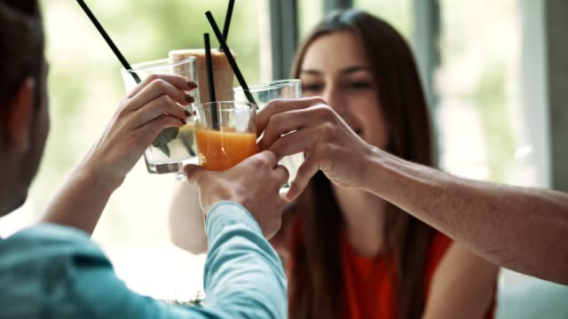 friends toasting with drinks in cafe - juice drink stock videos & royalty-free footage