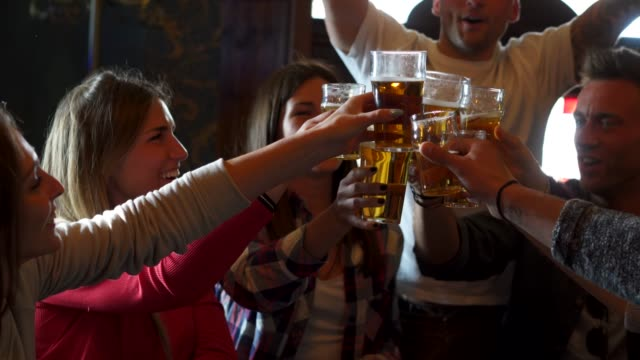 friends together at the pub - pub stock videos & royalty-free footage