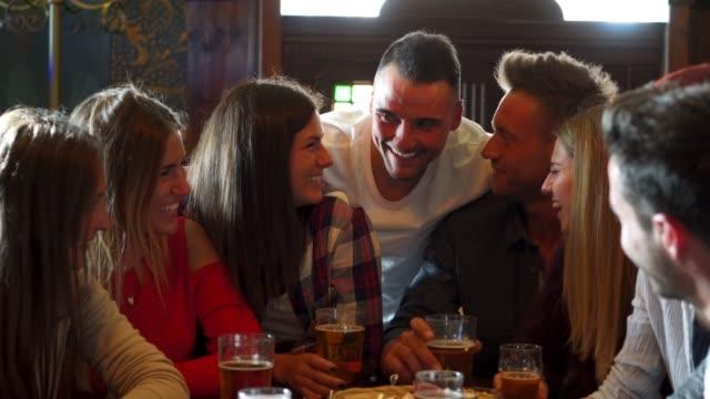 friends together at the pub - aperitivo video stock e b–roll