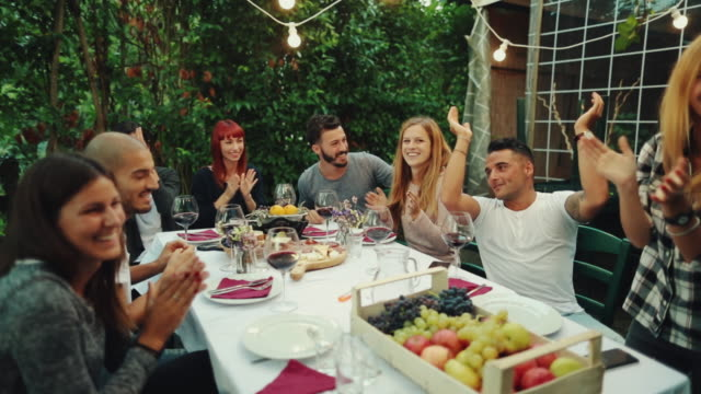 friends together enjoy meal and red wine in italy - inn stock videos and b-roll footage