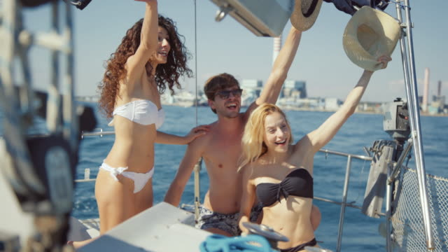 friends together on a yacht sailboat cruising the sea - turista video stock e b–roll