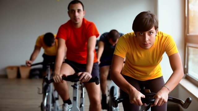 Friends training Spinning at Gym