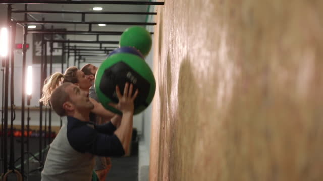 Friends training in gym