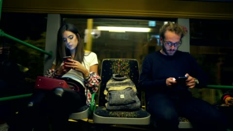friends using cellphones in the bus - public transport stock videos & royalty-free footage