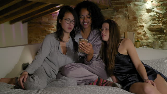 friends using smartphone - slumber party stock videos and b-roll footage