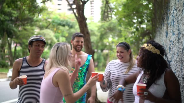 friends walking at street on the way carnival party in brazil - doing celebratory toast - traditional festival stock videos & royalty-free footage