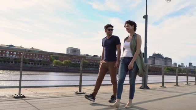 friends walking in puerto madero - puerto madero stock videos & royalty-free footage
