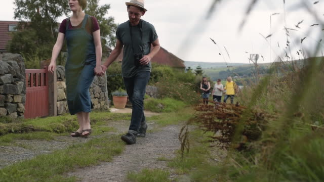 friends walking in the country - village stock videos & royalty-free footage