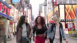 Friends Walking on a Street in Tokyo