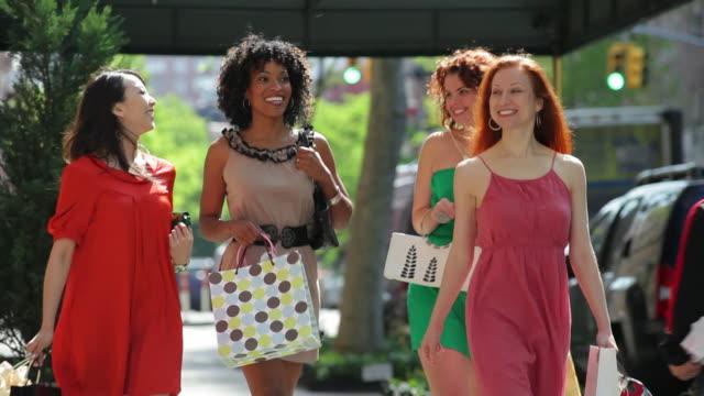 WS Friends walking on sidewalk / NYC, New York, United States