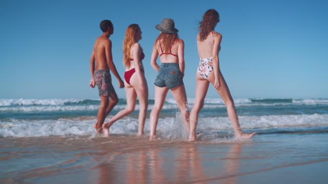 friends walking on the beach - swimwear videos stock videos and b-roll footage