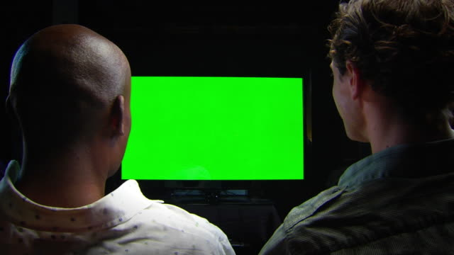 friends watch chromakey tv - locked two-shot - entertainment center stock videos and b-roll footage