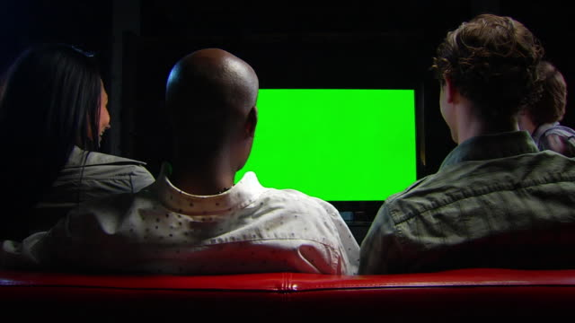 friends watch chromakey tv - locked wide shot - entertainment center stock videos and b-roll footage