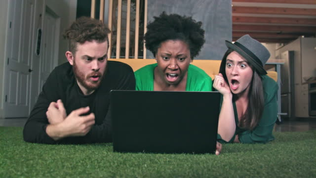 friends watch frightening show on laptop computer - glee tv show stock videos and b-roll footage