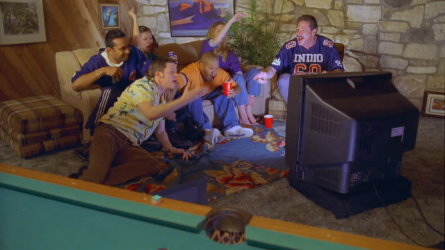 ws zi friends watching tv and laughing / canyon lake, texas, usa - canyon lake stock videos & royalty-free footage