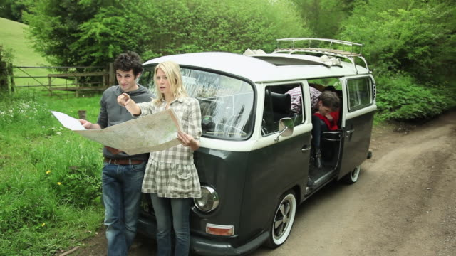 friends with camper van looking at map - guildford stock videos & royalty-free footage