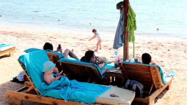 Friends with children relax on the sea. Sharm El Sheikh. Egypt.