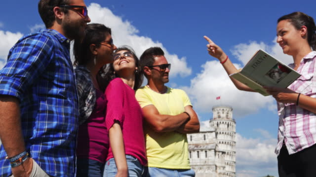friends with tourist guide in piazza dei miracoli - guide stock videos & royalty-free footage