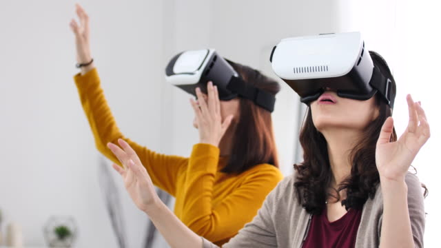 Friends with VR headset exploring virtual reality