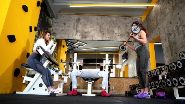 friends working out together in the gym - sports equipment stock videos & royalty-free footage