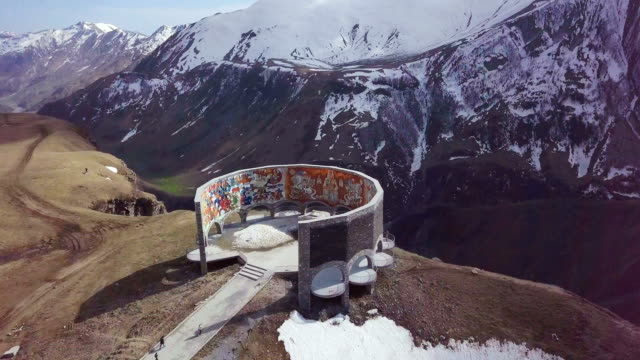 friendship monument, the military highway, caucasus, georgia / vertical aerial - caucasus stock videos and b-roll footage