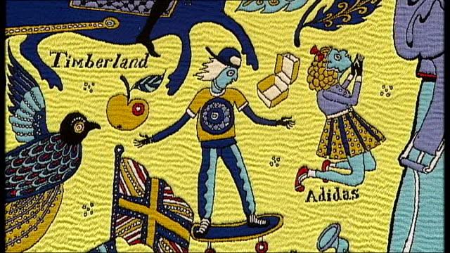 vídeos y material grabado en eventos de stock de grayson perry various shots of grayson perry tapestry 'the walthamstow tapestry' - entabladura