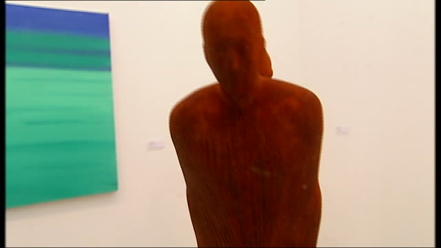london int painting of blank featured person against green background grayson perry sculpture of small person with dog as looked at by visitors to... - bust sculpture stock videos and b-roll footage