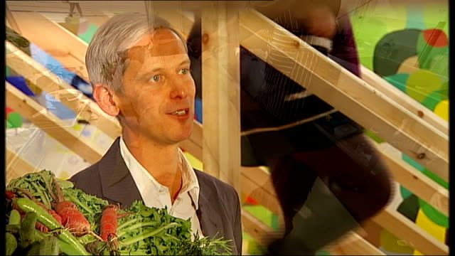 role of food in contemporary art; 'colosseum of the consumed' / grizedale arts performers stand against wall as tomatoes thrown at them grizedal arts... - display cabinet stock videos & royalty-free footage