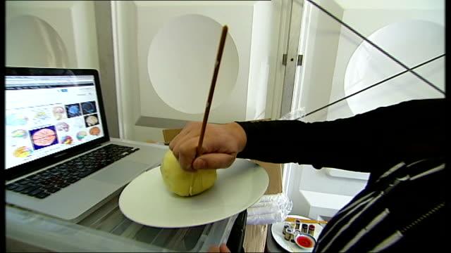 vídeos y material grabado en eventos de stock de role of food in contemporary art england london regent's park frieze art fair int various of grizedale arts members constructing large cake in the... - entabladura