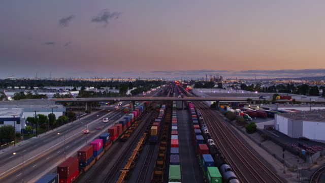 fright trains on the  alameda corridor, los angeles at dusk - trucks in a row stock videos & royalty-free footage