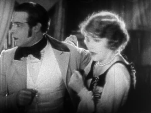 frightened couple looking at each other / feature - anno 1925 video stock e b–roll