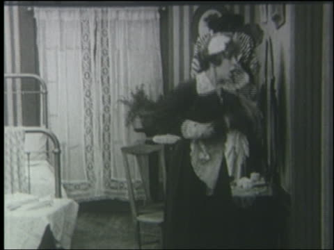 B/W 1915 frightened maid screaming + shaking feather duster