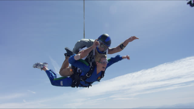 frightened tandem student jumps with friends - tandem stock videos & royalty-free footage