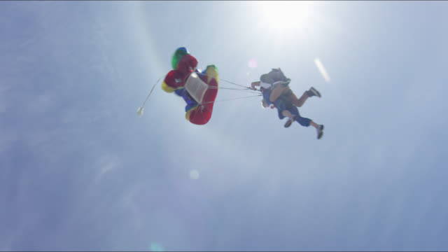 frightened tandem student jumps with friends - parachute stock videos & royalty-free footage