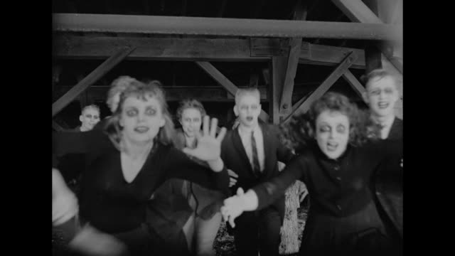1962 frightened woman is overtaken by group of ghosts - zombie stock videos & royalty-free footage