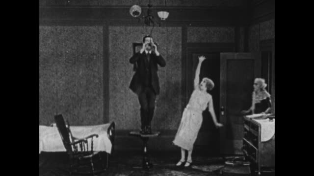 1924 frightened woman runs away screaming at sight of man trying to hang himself - hysteria stock videos & royalty-free footage