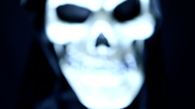 frightening skull fading into frame - skull stock videos and b-roll footage