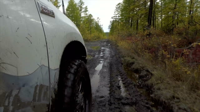 POV off-road 4x4 car driving on road