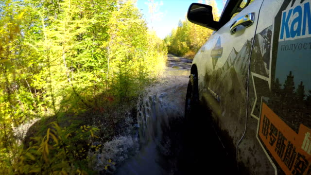 pov off-road 4x4 car driving on road,russia. - zweig stock-videos und b-roll-filmmaterial