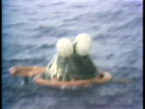 frogmen carry an egress raft to the apollo 13 spacecraft after it splashes down in the south pacific. - south pacific ocean stock videos & royalty-free footage