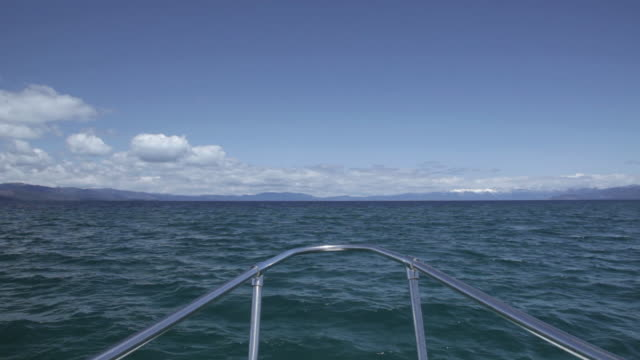 pov from a boat on lake tahoe - seeufer stock-videos und b-roll-filmmaterial