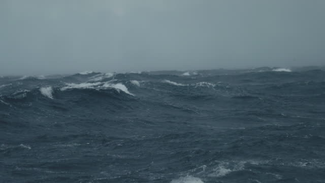 from a boat sailing in a stormy rough sea - side view stock videos & royalty-free footage