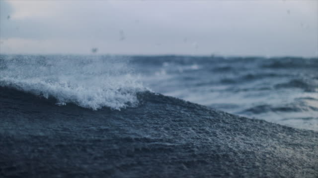 from a boat sailing in a stormy rough sea - sea tide stock videos & royalty-free footage