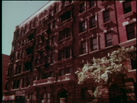 pov from a car driving along adam clayton powell jr avenue tenements apartment buildings shops and bars wilmac room - adam clayton powell jr stock videos & royalty-free footage