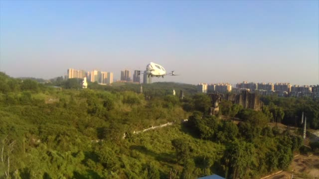 POV from a drone following an EHang Inc E184 drone as it takes off flies and lands at the company's headquarters in Guangzhou China on Thursday Nov 2...